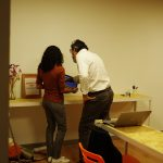 Dhania y Ferran trabajando en el evento power bi barcelona